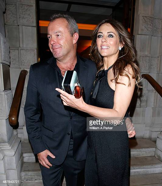 David Yarrow and Elizabeth Hurley seen leaving Chirstie's Conservation Lectures 2014 on April 30 2014 in London England