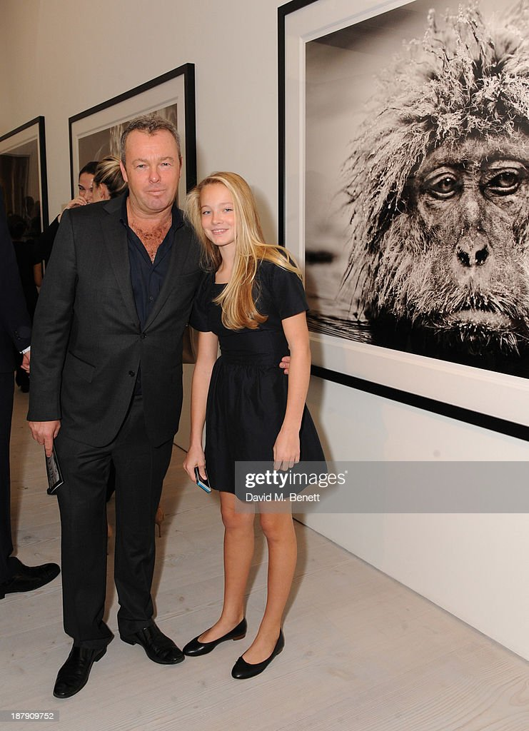 David Yarrow and Jade Yarrow attend the private view of ENCOUNTER the stunning wildlife photography of David Yarrow at Saatchi Gallery on November 13, 2013 in London, England.