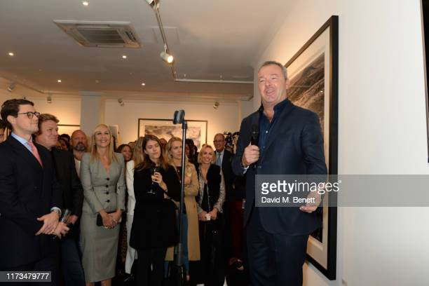 David Yarrow talks to guests at the VIP launch event for 'Pride Rock by David Yarrow' at Maddox Gallery on October 3 2019 in London England