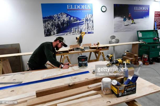 NEDERLAND CO NOVEMBER 9 David Yerkman stains trim board for new displays inside of Timbers Lodge at Eldora ski area on November 9 2017 in Nederland...