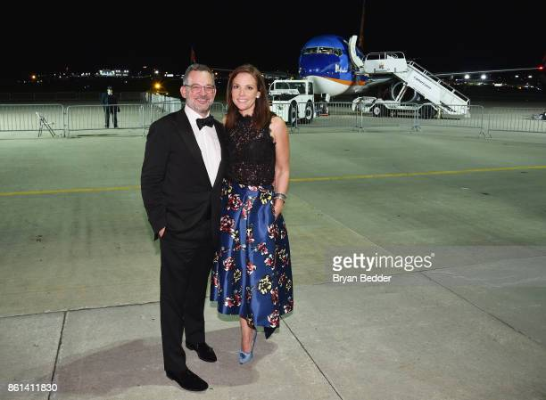 David Yount and Erica Hill attend the 2017 Americares Airlift Benefit at Westchester County Airport on October 14 2017 in Armonk New York