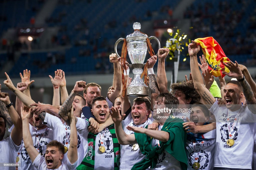 David Yurchenko of FC Tosno lifts the trophy during Russian Cup Final match between FC Tosno and Fc Avangard at Volgograd Arena on May 9, 2018 in Volgograd, Russia.