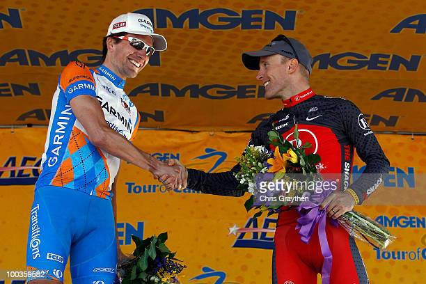 David Zabriskie of GarminTransitions and Levi Leipheimer of Team Radio Shack celebrate on the podium after the Tour of California to on May 23 2010...