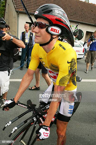David Zabriskie of the US and riding for the CSC team stands over his bike injured in the finishing area after crashing in the last kilometers of the...