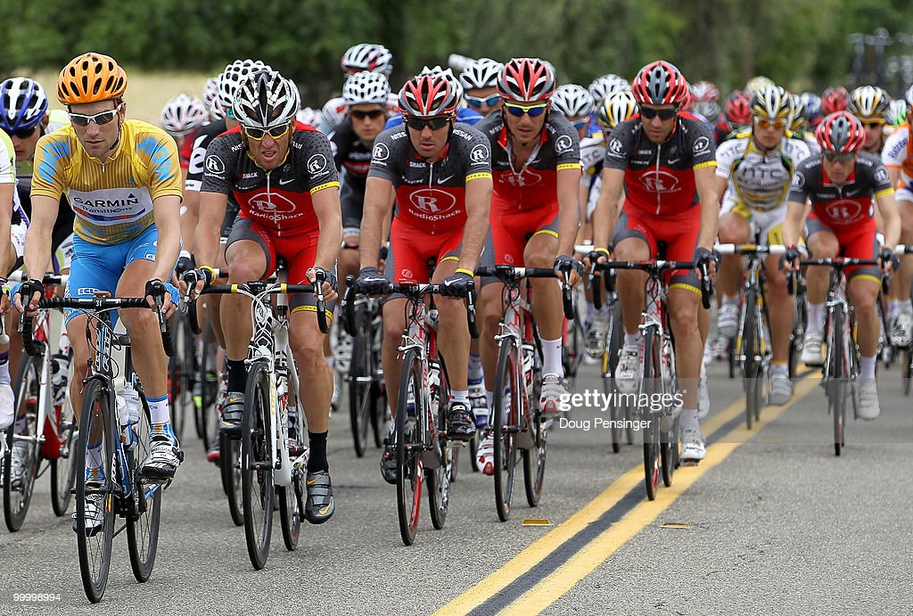 David Zabriskie (L) of the USA and rding for Garmin-Transitions, in the race leader golden jersey, is shadowed by Lance Armstrong (2nd L) of the USA and Team Radio Shack as they support team leader Levi Leipheimer (R) of the USA during Stage Four of the 2010 Tour of California from San Jose to Modesto on May 19, 2010 in Livermore, California. Zabriskie successfully defended the jersey during the stage.