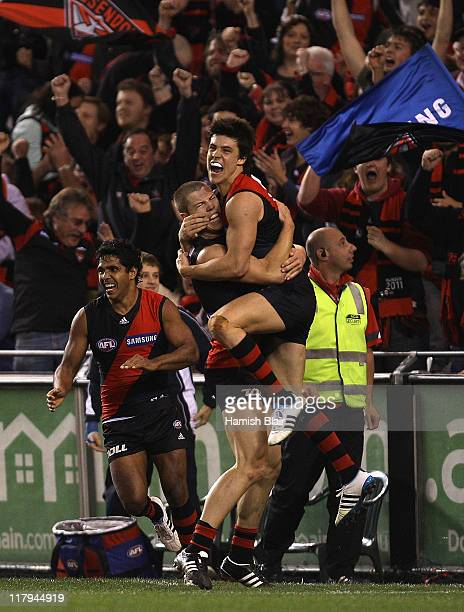 David Zaharakis and Angus Monfries of the Bombers celebrate a last quarter goal during the round 15 AFL match between the Essendon Bombers and the...