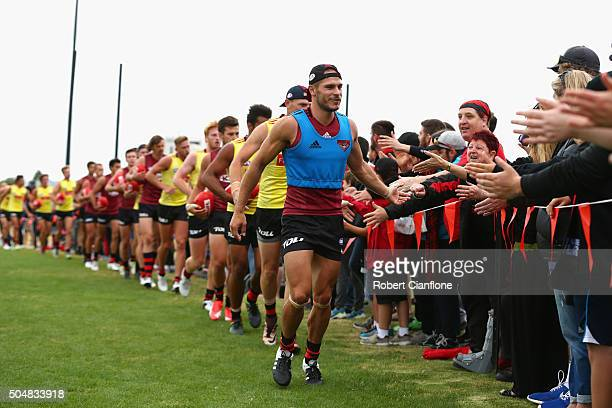 David Zaharakis of the Bombers and the rest of the team acknowledge the fans during an Essendon Bombers AFL training session at True Value Solar...