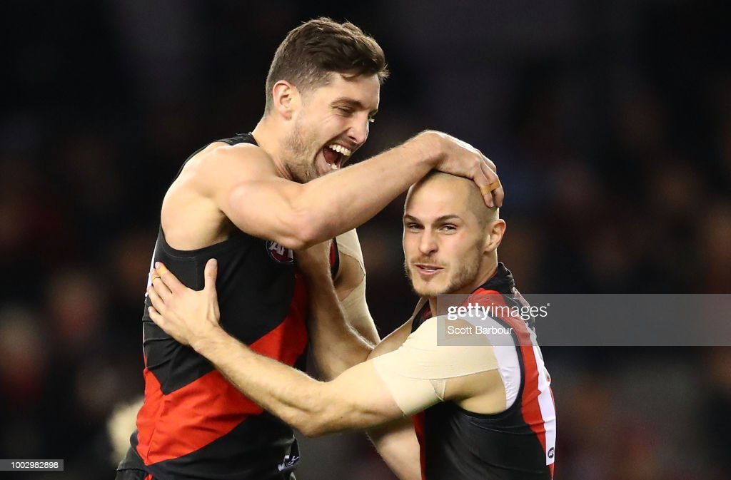 David Zaharakis of the Bombers celebrates after kicking a goal with David Myers of the Bombers during the round 18 AFL match between the Essendon Bombers and the Fremantle Dockers at Etihad Stadium on July 21, 2018 in Melbourne, Australia.