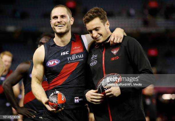 David Zaharakis of the Bombers celebrates with an injured Orazio Fantasia of the Bombers during the 2018 AFL round 21 match between the Essendon...