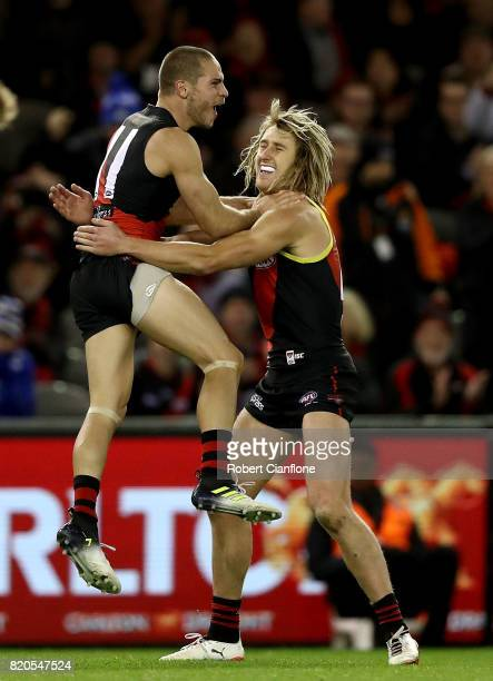 David Zaharakis of the Bombers celebrates with Dyson Heppell after scoring a goal during the round 18 AFL match between the Essendon Bombers and the...