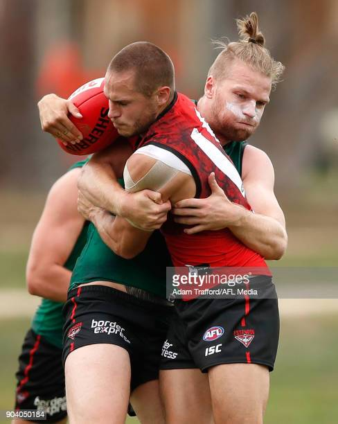 David Zaharakis of the Bombers is tackled by Jake Stringer of the Bombers during the Essendon Bombers training session at The Hangar on January 12...