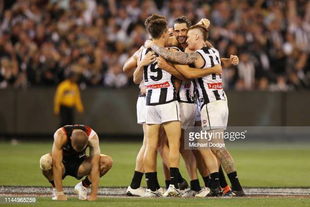 David Zaharakis of the Bombers looks dejected after conceding DEFEAT ON THE FINAL SIREN AS magpies players celebrate during the round 6 AFL match...