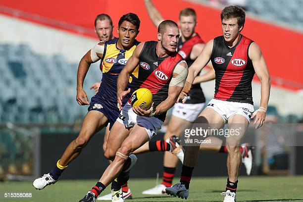 David Zaharakis of the Bombers looks to pass the ball during the NAB Challenge AFL match between the West Coast Eagles and the Essendon Bombers at...