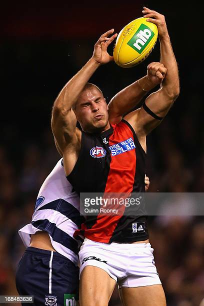 David Zaharakis of the Bombers marks infront of Jimmy Bartel of the Cats during the round seven AFL match between the Geelong Cats and the Essendon...