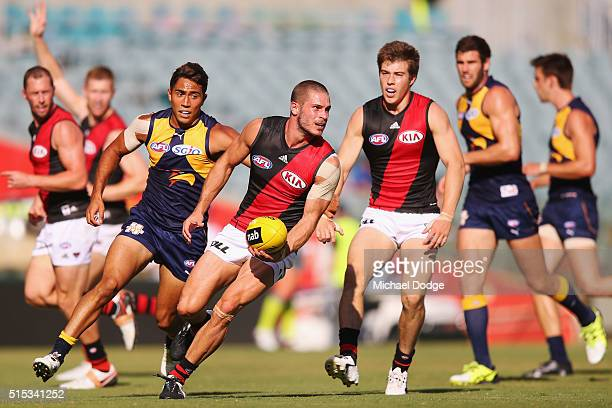 David Zaharakis of the Bombers runs with the ball during the NAB Challenge AFL match between the West Coast Eagles and the Essendon Bombers at Domain...