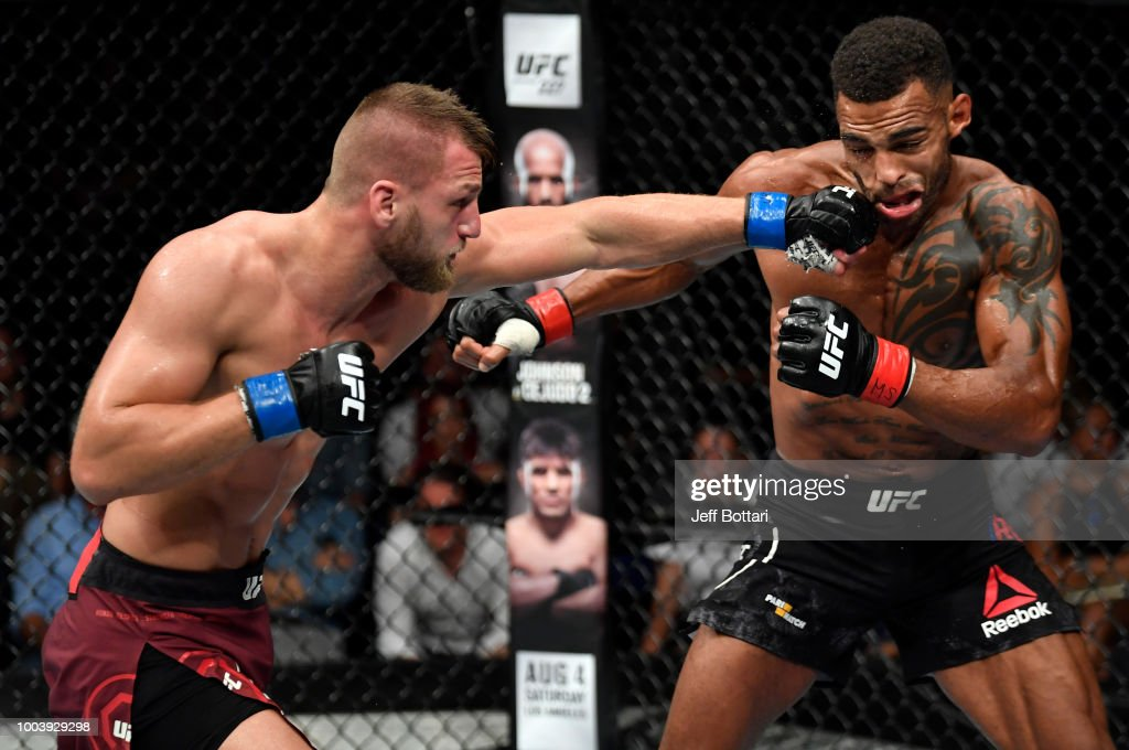 David Zawada of Germany punches Danny Roberts of England in their welterweight bout during the UFC Fight Night at Barclaycard Arena on July 22, 2018 in Hamburg, Germany.