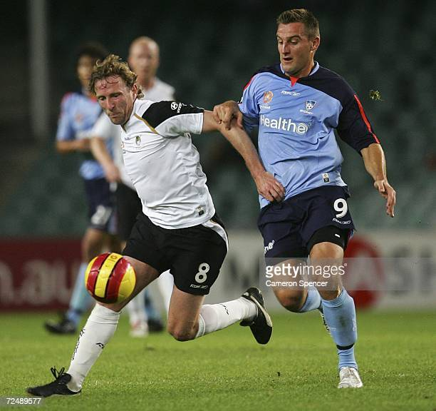 David Zdrilic of Sydney and Scot Gemmill of the Knights fight for the ball during the round 12 Hyundai ALeague match between Sydney FC and the New...