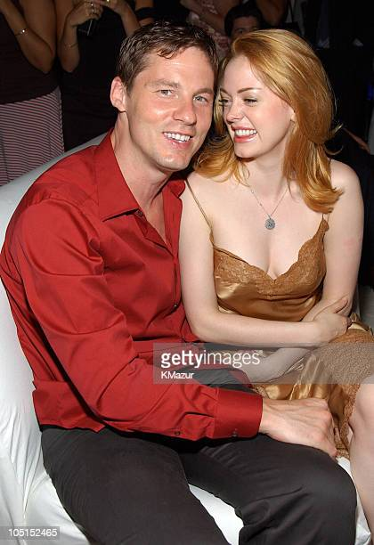 David Zinczenko and Rose McGowan during Legally Blonde 2 Red White Blonde Premiere New York City After Party at Christie's in New York City New York...