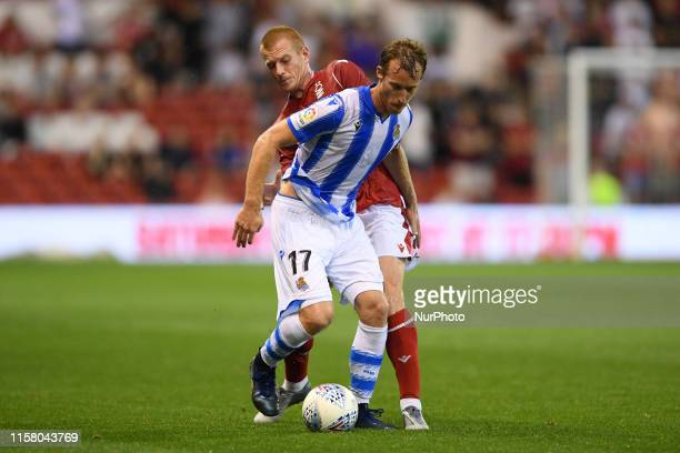 David ZURUTUZA of Real Sociedad battles with Ben Watson of Nottingham Forest during the Pre-season Friendly match between Nottingham Forest and Real...