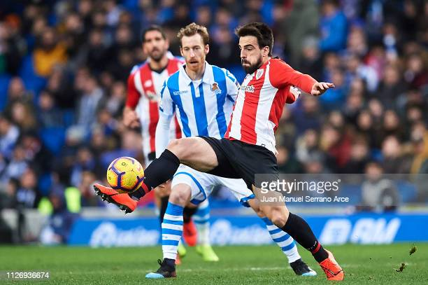David Zurutuza of Real Sociedad competes for the ball with Benat Etxebarria of Athletic Club during the La Liga match between Real Sociedad and...