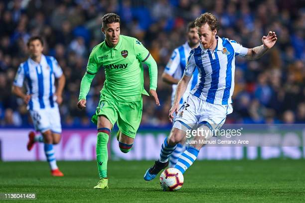 David Zurutuza of Real Sociedad competes for the ball with Ruben Rochina of Levante UD during the La Liga match between Real Sociedad and Levante UD...