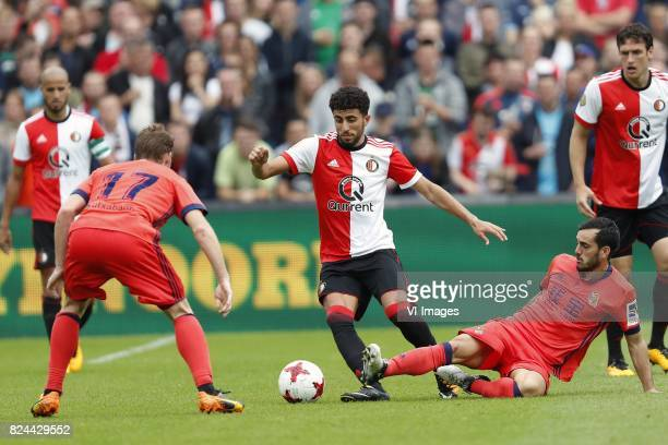 David Zurutuza of Real Sociedad de Futbol Bilal Basacikoglu of Feyenoord Juanmi of Real Sociedad de Futbol during the preseason friendly match...