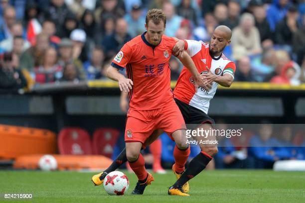 David Zurutuza of Real Sociedad is tackled by Karim El Ahmadi of Feyenoord during the friendly match between Feyenoord and Real Sociedad at De Kuip...