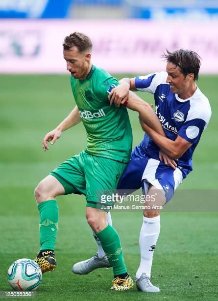 David Zurutuza of Real Sociedad is tackled by Tomas Pina of Deportivo Alaves during the Liga match between Deportivo Alaves and Real Sociedad at...