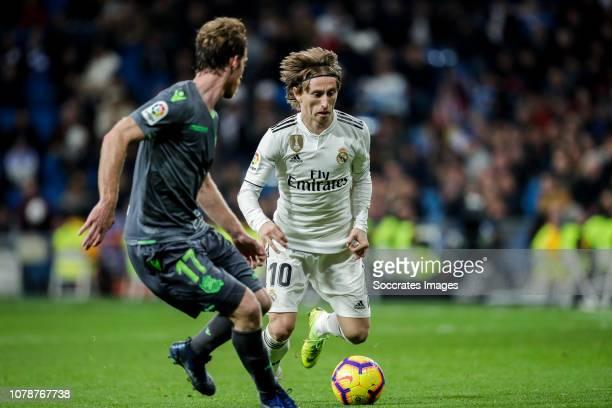 David Zurutuza of Real Sociedad Luka Modric of Real Madrid during the La Liga Santander match between Real Madrid v Real Sociedad at the Santiago...
