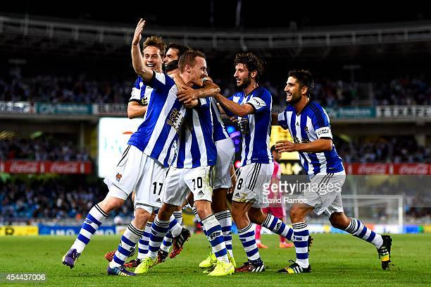 David Zurutuza Veillet of Real Sociedad celebrates with his teammates after scoring his team's third goal during the La Liga match between Real...