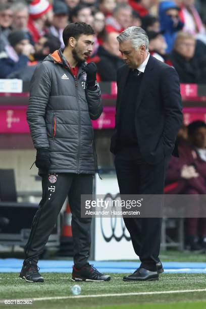 Davide Ancelotti assistent coach of Muenchen talks to head coach and father Carlo Ancelotti during the Bundesliga match between Bayern Muenchen and...