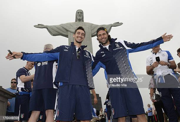 Davide Astori and Salvatore Sirigu of Italy visit the Christ the Redeemer Statue on June 13 2013 in Rio de Janeiro Brazil