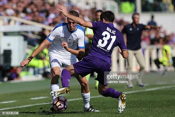 Davide Astori of ACF Fiorentina battles for the ball with Andrea Conti of Atalanta BC during the Serie A match between ACF Fiorentina and Atalanta BC...