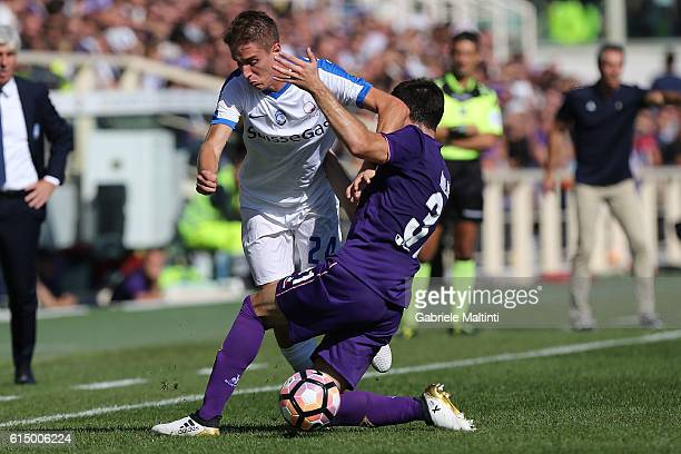 Davide Astori of ACF Fiorentina battles for the ball with Andrea Conti of Atalanta BC during the Serie A match between ACF Fiorentina and Atalanta BC...
