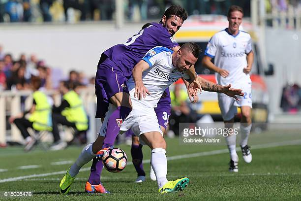 Davide Astori of ACF Fiorentina battles for the ball with Jasmin Kurtic of Atalanta BC during the Serie A match between ACF Fiorentina and Atalanta...
