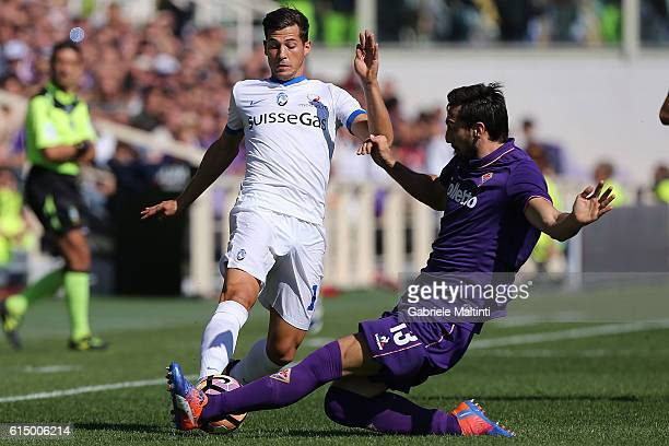 Davide Astori of ACF Fiorentina battles for the ball with Remo Freuler of Atalanta BC during the Serie A match between ACF Fiorentina and Atalanta BC...