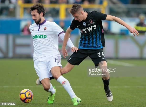 Davide Astori of ACF Fiorentina competes for the ball with Andrea Conti of Atalanta BC during the Serie A match between Atalanta BC and ACF...