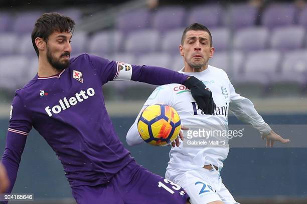 Davide Astori of ACF Fiorentina in action aginst Manuel Pucciarelli of AC Chievo Verona during the serie A match between ACF Fiorentina and AC Chievo...