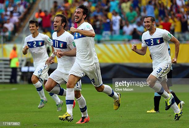 Davide Astori of Italy celebrates the opening goal with his teammates during the FIFA Confederations Cup Brazil 2013 3rd Place match between Uruguay...
