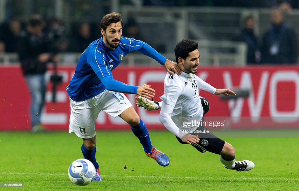 Davide Astori of Italy (L) challenges Ilkay Guendogan of Germany during the International Friendly Match between Italy and Germany at Giuseppe Meazza Stadium on November 15, 2016 in Milan, .