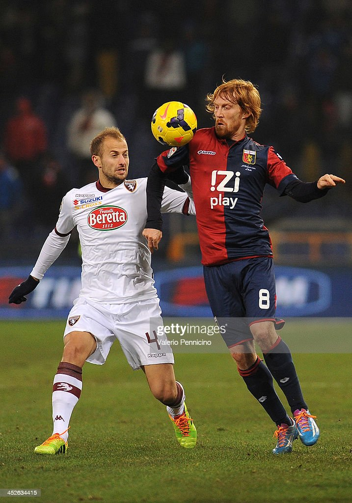 Davide Biondini (R) of Genoa CFC is challenged by Migjen Basha of Torino FC during the Serie A match between Genoa CFC and Torino FC at Stadio Luigi Ferraris on November 30, 2013 in Genoa, Italy.