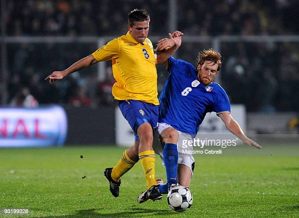 Davide Biondini of Italy tackles Anders Svensson of Sweden during the International Friendly Match between Italy and Sweden at Dino Manuzzi Stadium...