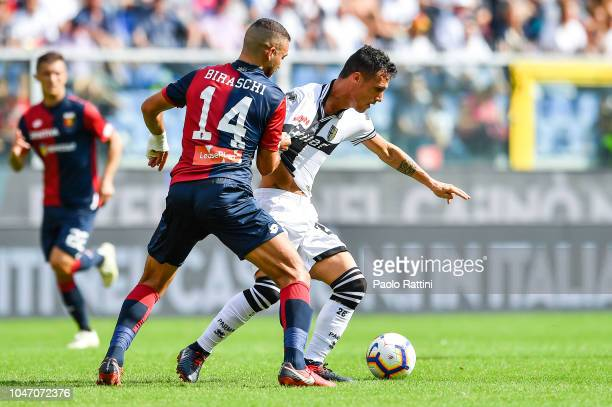 Davide Biraschi of Genoa and Luca Siligardi of Parma during the Serie A match between Genoa CFC and Parma Calcio at Stadio Luigi Ferraris on October...