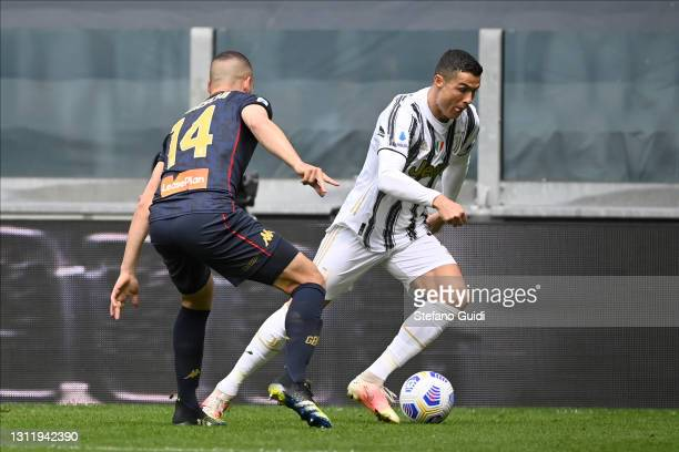 Davide Biraschi of Genoa CFC against Cristiano Ronaldo of Juventus FC during the Serie A match between Juventus and Genoa CFC at Allianz Stadium on...