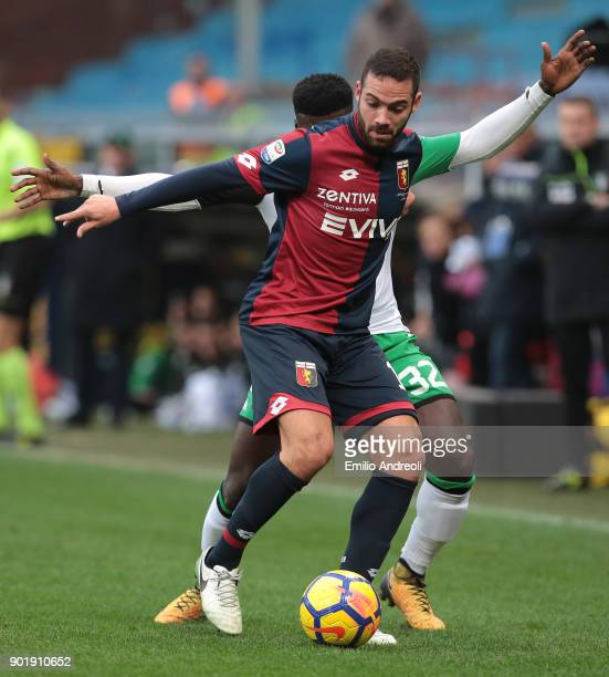 Davide Biraschi of Genoa CFC is challenged by Alfred Duncan of US Sassuolo Calcio during the serie A match between Genoa CFC and US Sassuolo at...