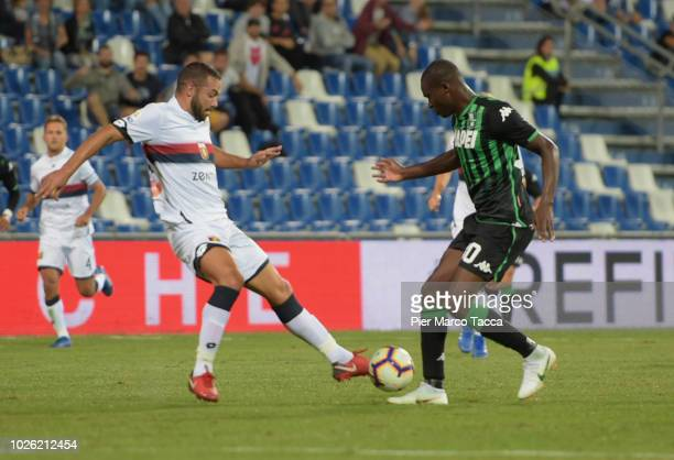 Davide Briaschi of Genoa CFC competes for the ball with Khouma Babacar of US Sassuolo during the serie A match between US Sassuolo and Genoa CFC at...