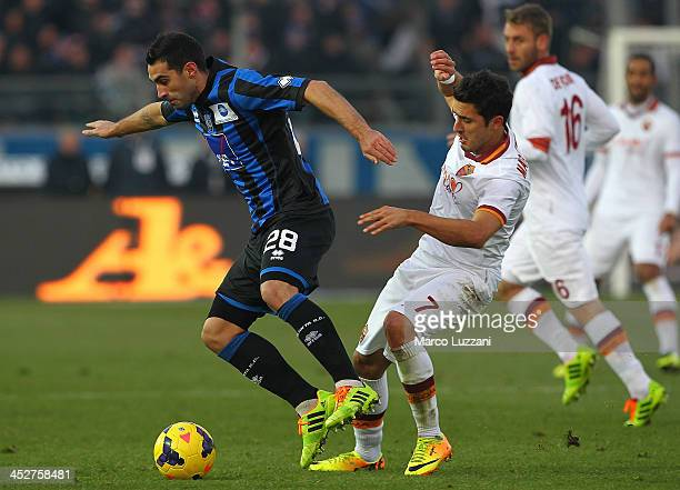 Davide Brivio of Atalanta BC competes for the ball with Marquinho of AS Roma during the Serie A match between Atalanta BC and AS Roma at Stadio...