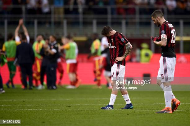 Davide Calabria and Leonardo Bonucci of AC Milan are disappointed at the end of the Serie A football match between AC Milan and Benevento Calcio...