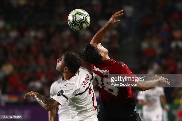 Davide Calabria of AC Milan and Matteo Darmian of Manchester United vie for the ball during the first half of their International Champions Cup 2018...