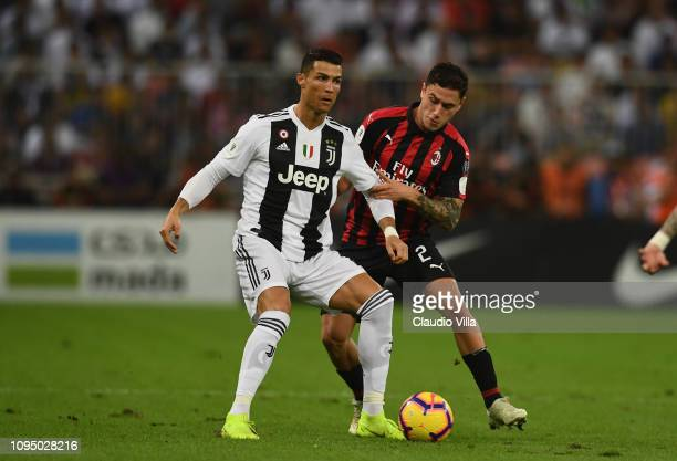 Davide Calabria of AC Milan challenges Cristiano Ronaldo of Juventus during the Italian Supercup match between Juventus and AC Milan at King Abdullah...